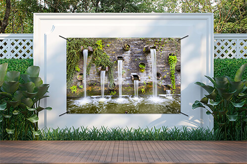 Garden poster Rocky wall with small waterfalls