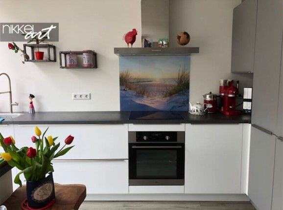 Glass kitchen splashback with a photo of a beach
